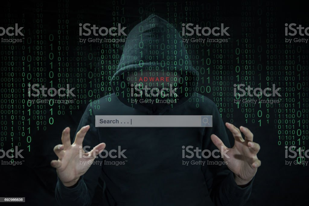 Hacker using adware to control search engine on computer stock photo