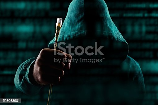 istock Hacker with unplugged network cable 528063901