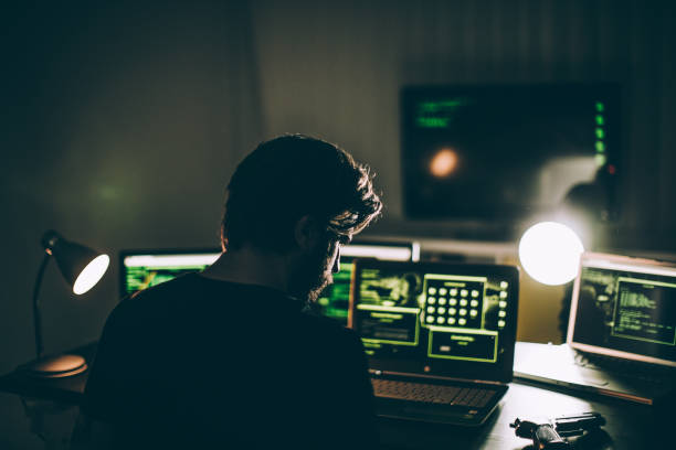 hacker working alone - laptop digital composite stock pictures, royalty-free photos & images