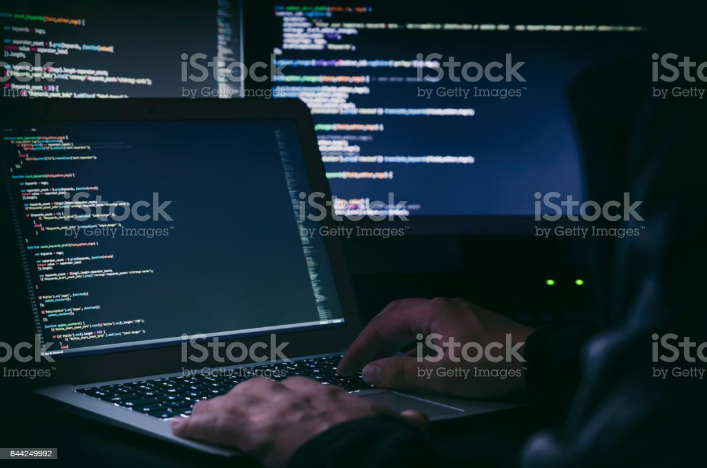 Hacker working on a code. Internet crime stock photo