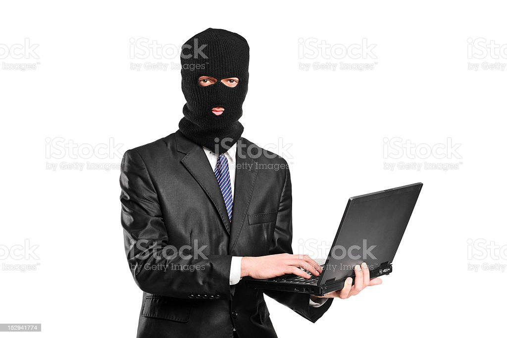 Hacker working on a laptop stock photo