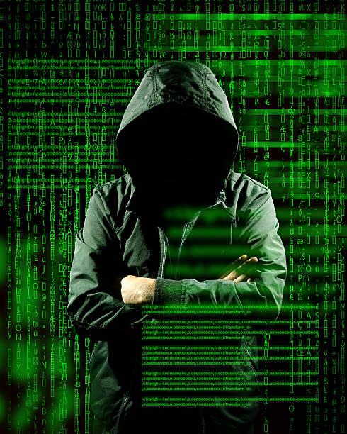 Hackers and green digital computer writing stock photo