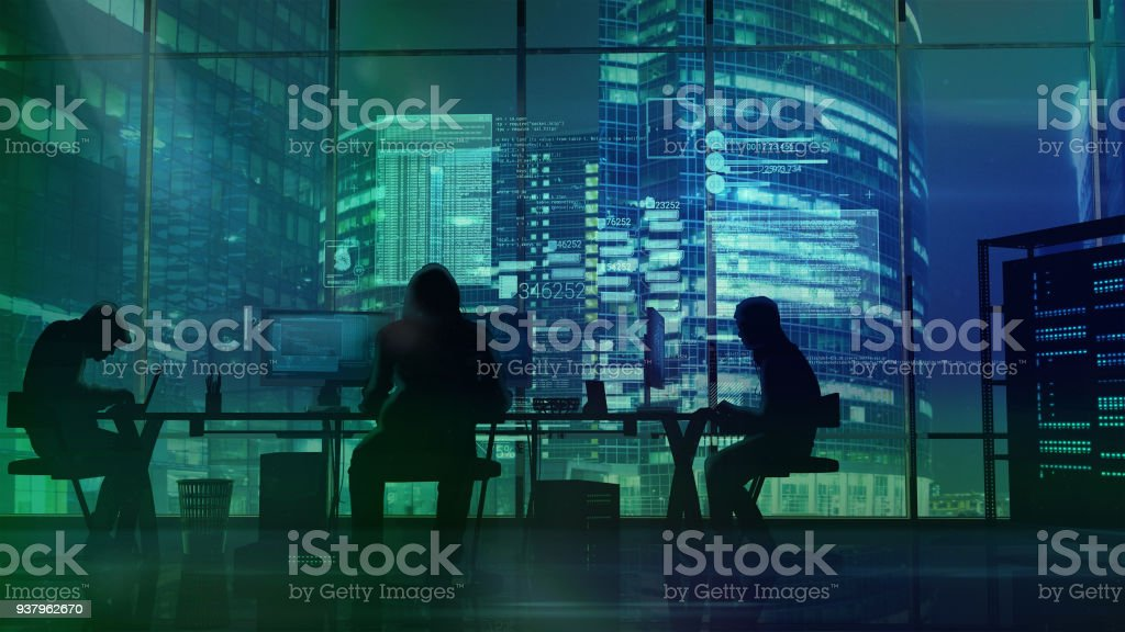 Hackers at work on the background of green office buildings stock photo