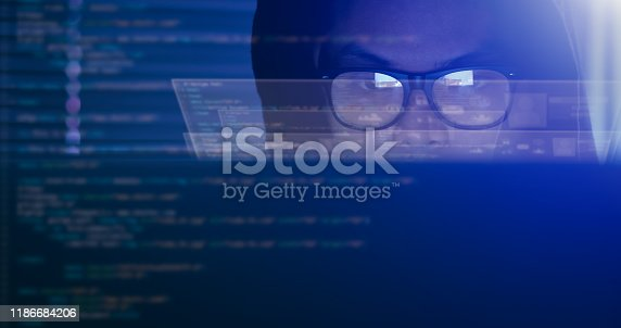 istock Hacking and internet crime concept, hacker using computer coding on digital interface. 1186684206