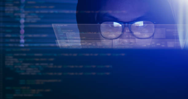 Hacking and internet crime concept, hacker using computer coding on digital interface. stock photo