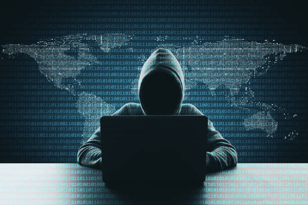 Hacking and phishing concept Hacker using laptop on abstract binary code map background. Hacking and phishing concept computer crime stock pictures, royalty-free photos & images