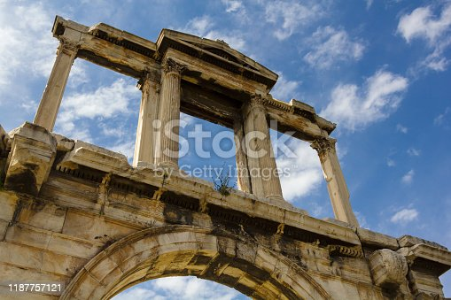 Hadrian's Gate in Athens,Greece. Detail on blue sky with clouds background.
