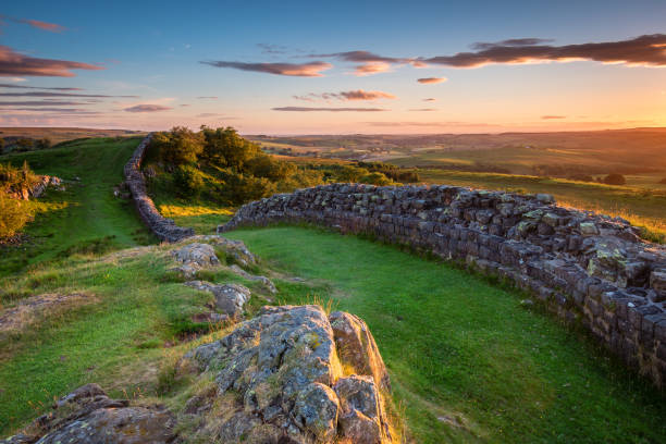 Hadrian's Wall near sunset at Walltown Hadrian's Wall is a World Heritage Site in the beautiful Northumberland National Park. Popular with walkers along the Hadrian's Wall Path and Pennine Way northeastern england stock pictures, royalty-free photos & images