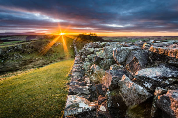 Hadrian's Wall, Northumberland Hadrian's Wall at Walltown Crags on a winter's day at sunset. northeastern england stock pictures, royalty-free photos & images