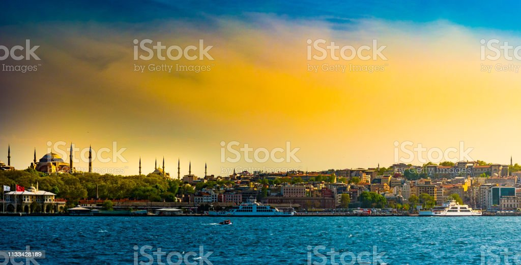 Hagia Sophia and Beautiful View touristic landmarks from sea voyage on Bosphorus. Cityscape of Istanbul at sunset. stock photo