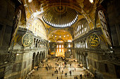 Hagia Sophia (Aya Sofya) indoors captured with fish-eye lens. Warm tone given. Unrecognizable people visible.See more Istanbul