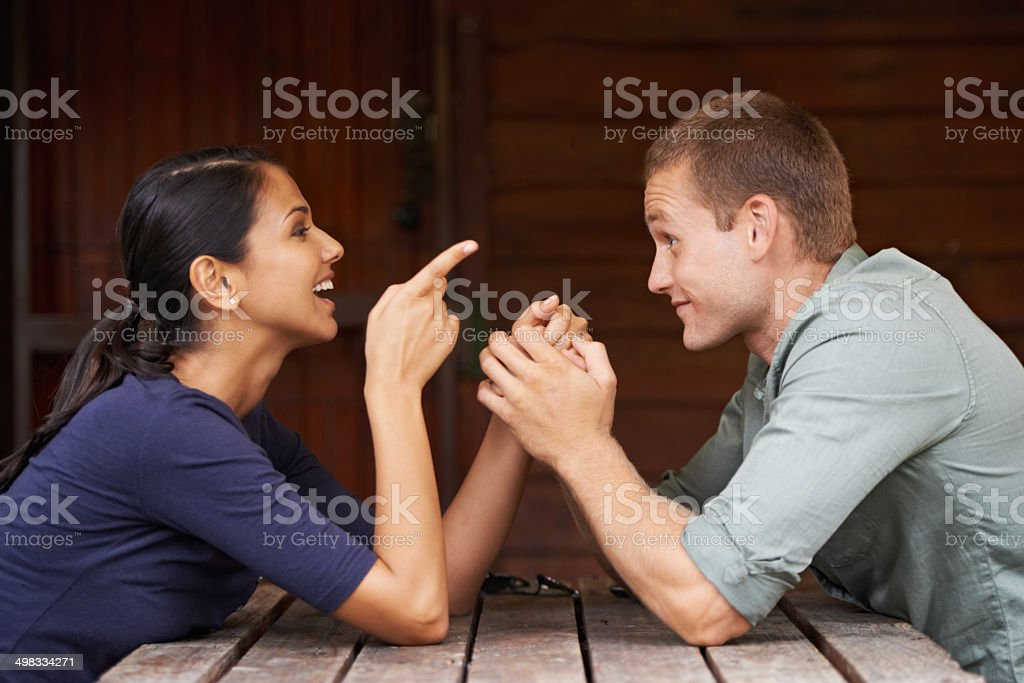Hahaa.. you are looking for trouble mister! A playful couple laughing while on a date at a cafehttp://195.154.178.81/DATA/i_collage/pi/shoots/783404.jpg 20-29 Years Stock Photo
