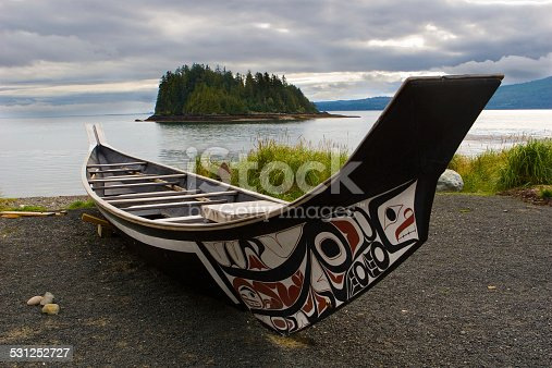 A canoe rests on the shoreline in Haida Gwaii.