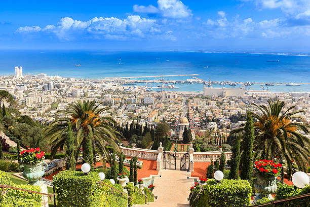 Haifa, Israel City of Haifa in Israel with the Bahai Garden and the habor in the back historical palestine stock pictures, royalty-free photos & images