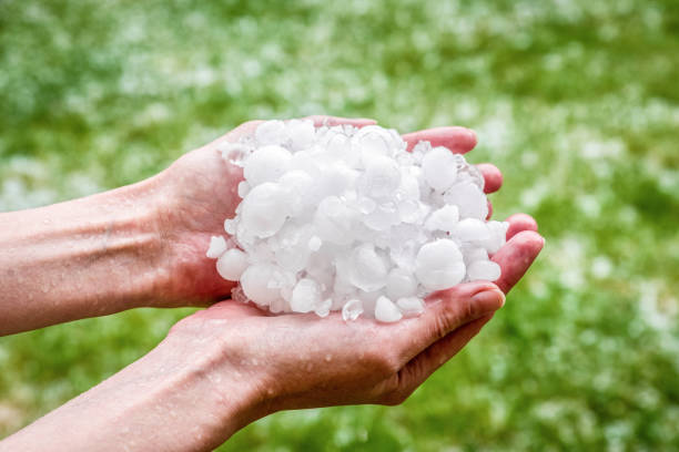 Hail in hands. Hailstorm stock photo