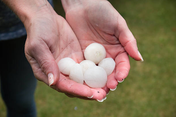 Hail in hands stock photo
