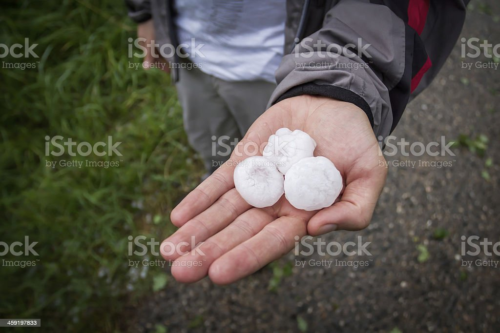 Hail in Man's Hand stock photo