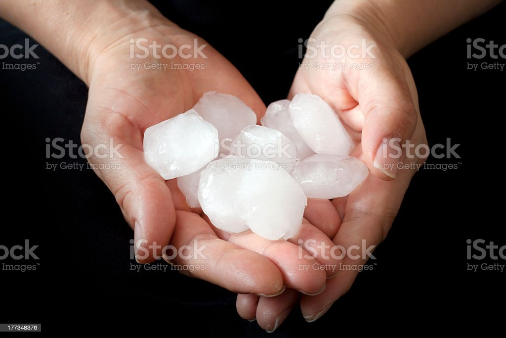 Hail pieces being held by hands stock photo
