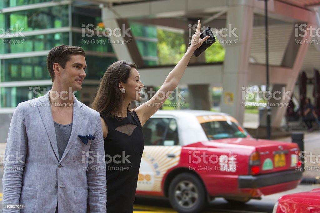 Hailing a Taxi stock photo