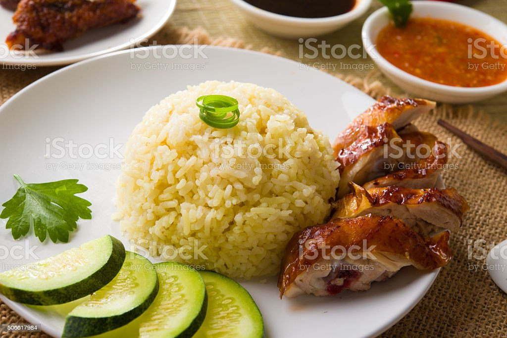 hainan chicken rice , singapore food with materials as backgrou stock photo