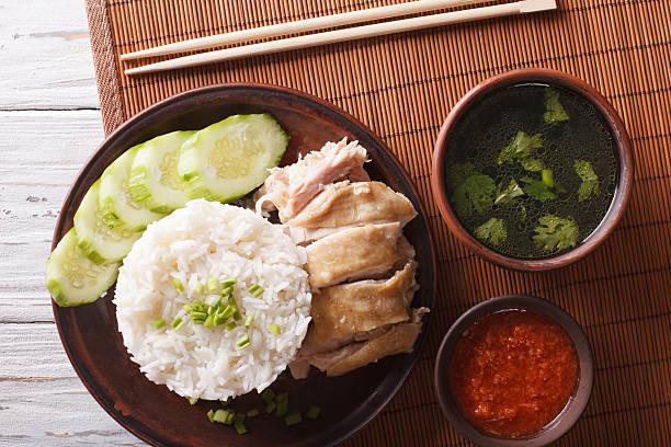 Hainanese chicken rice, chilli sauce and bouillon close-up stock photo