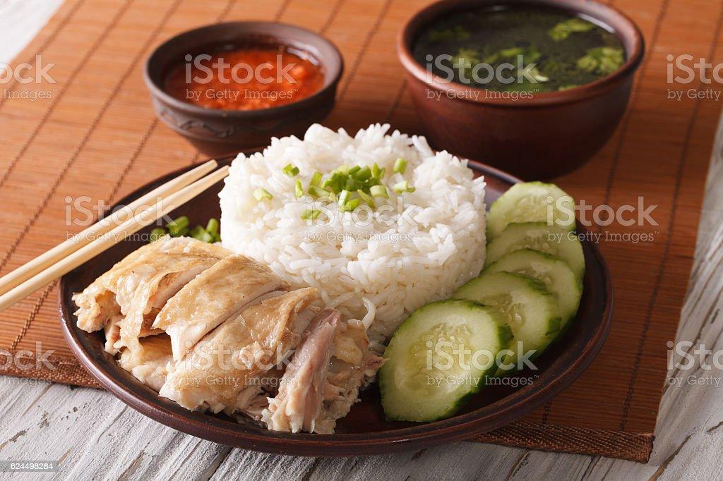 Hainanese chicken rice close-up, chili sauce and broth. Horizontal stock photo