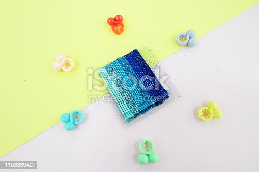 Hair Accessories Cyan Hairpin Set. Fashion Blue Hair Clips Isolated on Pink and Yellow Background.