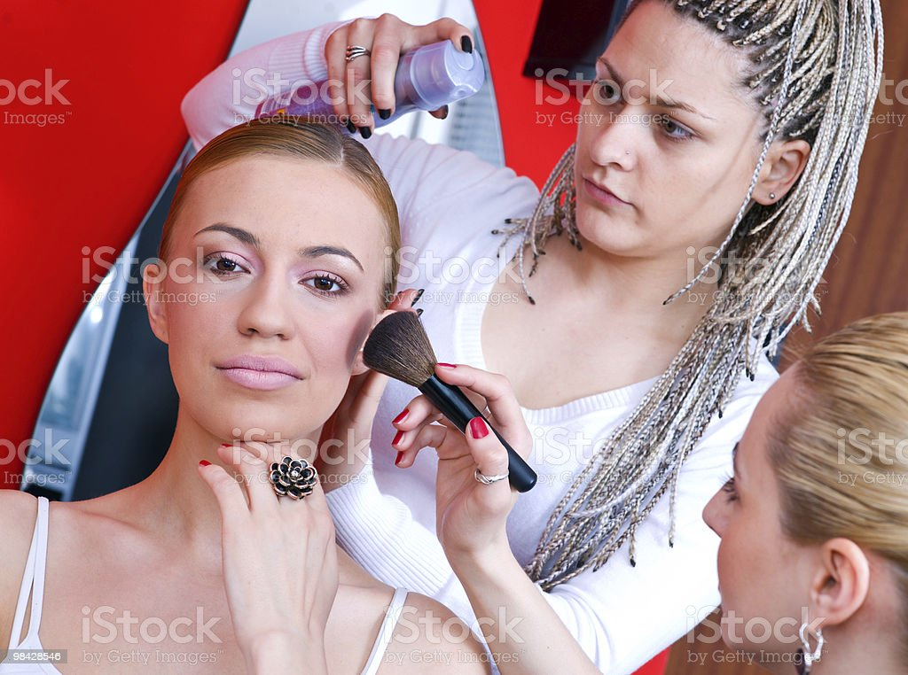 hair and make up stylist at work royalty-free stock photo