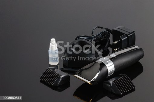 istock Hair Barber Clippers, Haircut accessories on the grey mirror background 1008560814