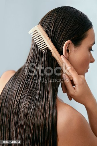 886414246istockphoto Hair Care. Beautiful Woman Brushing Wet Long Hair After Bath 1062840434