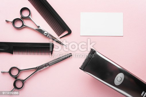 istock Hair Clipper and scissor the hairdressing on pink background 911459386