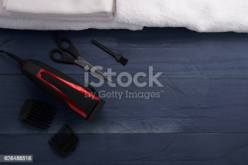 626488516istockphoto Hair Clipper and scissor the hairdressing salon 626488516