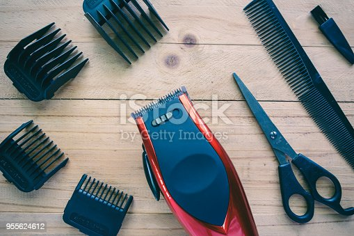 626488516istockphoto Hair clipper set on wood background for beauty salon equipment concept 955624612