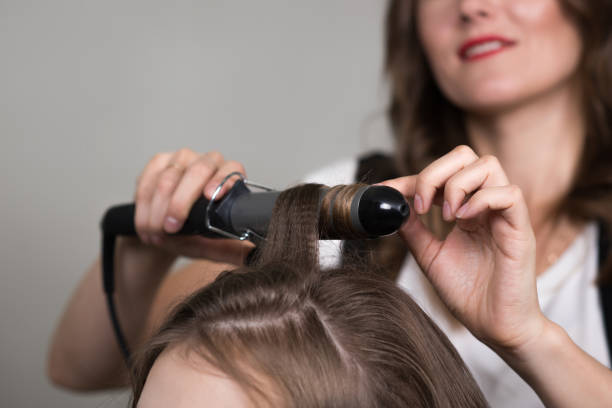Hair curling stock photo