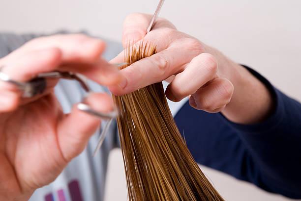 Hair Cutting At Hairdresser Spitzen schneiden beim Friseur mit HAnden im Vodergrund spiked stock pictures, royalty-free photos & images