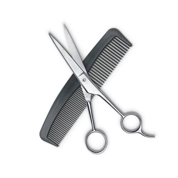 Hair cutting shears and comb isolated on white stock photo