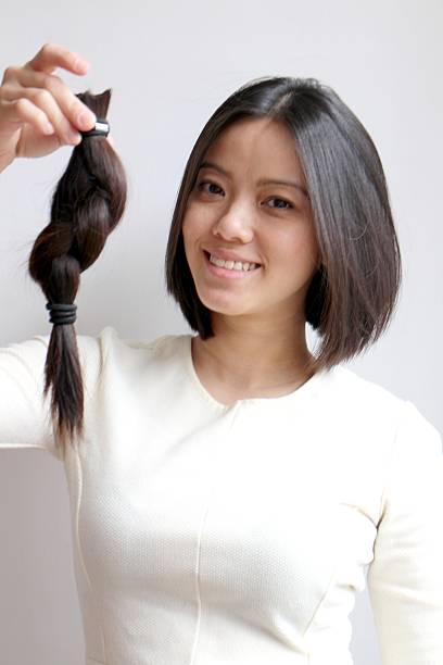 Hair donation for people who lost hair from cancer treatment stock photo