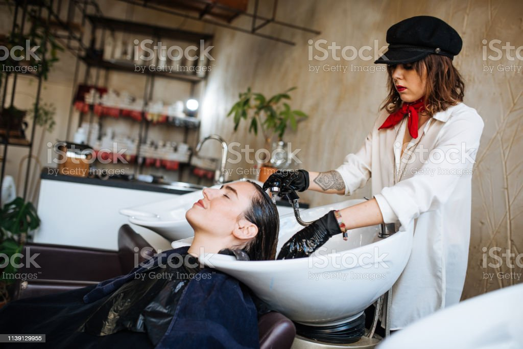 Young millennial woman at hair stylist