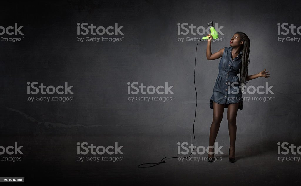 hair dresser with phon on hand stock photo