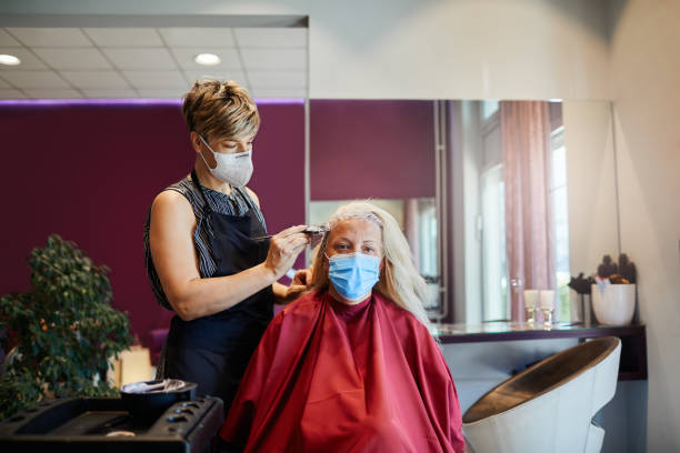 Hair Dresser Working With Face Mask During Coronavirus Pandemic