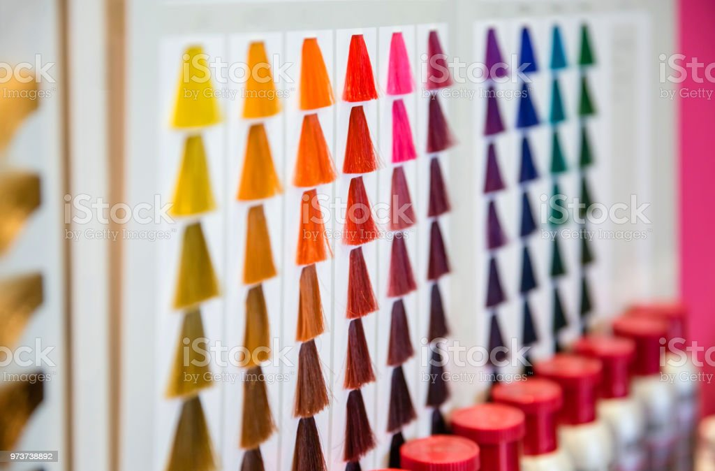 Closeup of hair dyed color shades palette in hair and beauty salon