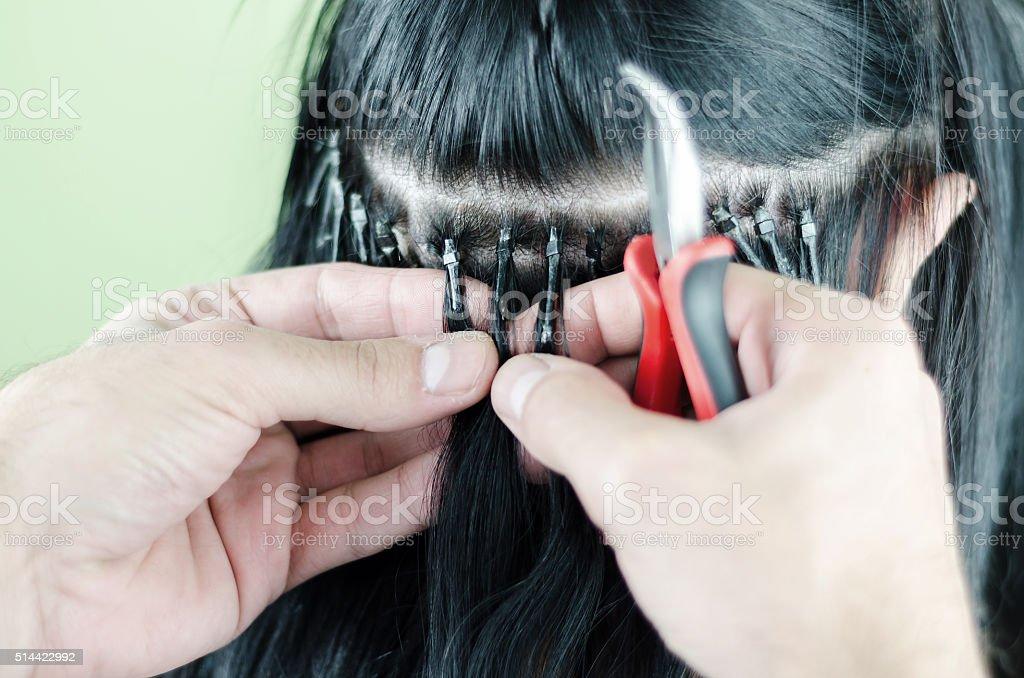 Prolongamento de cabelo em um fundo branco - foto de acervo
