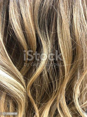 A woman's long blonde wavy hair