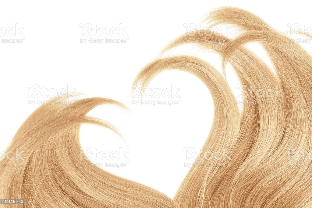 Hair in shape of heart on white stock photo
