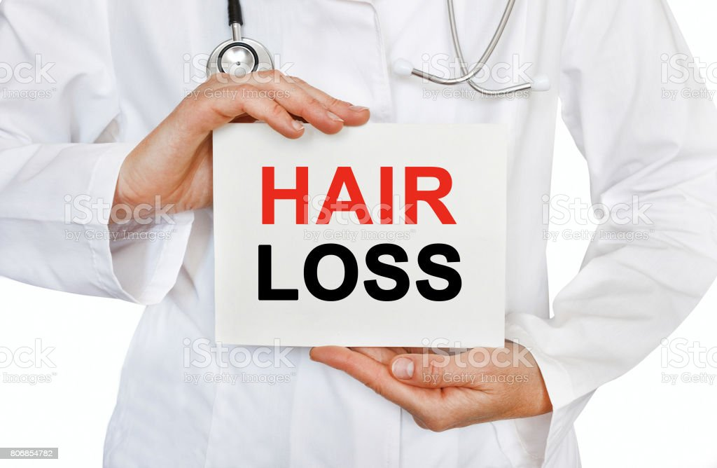 Hair Loss card in hands of Medical Doctor stock photo