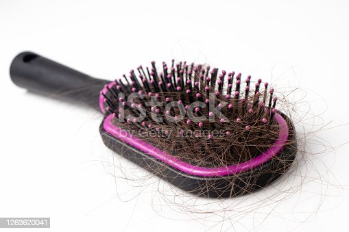 istock Hair loss on a comb on a white background. Baldness. 1263620041