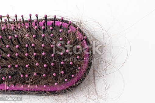 istock Hair loss on a comb on a white background. Baldness. 1263620132