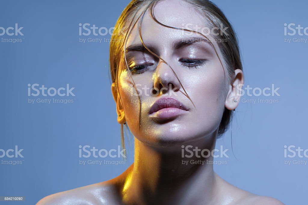 hair on the wet woman's face stock photo