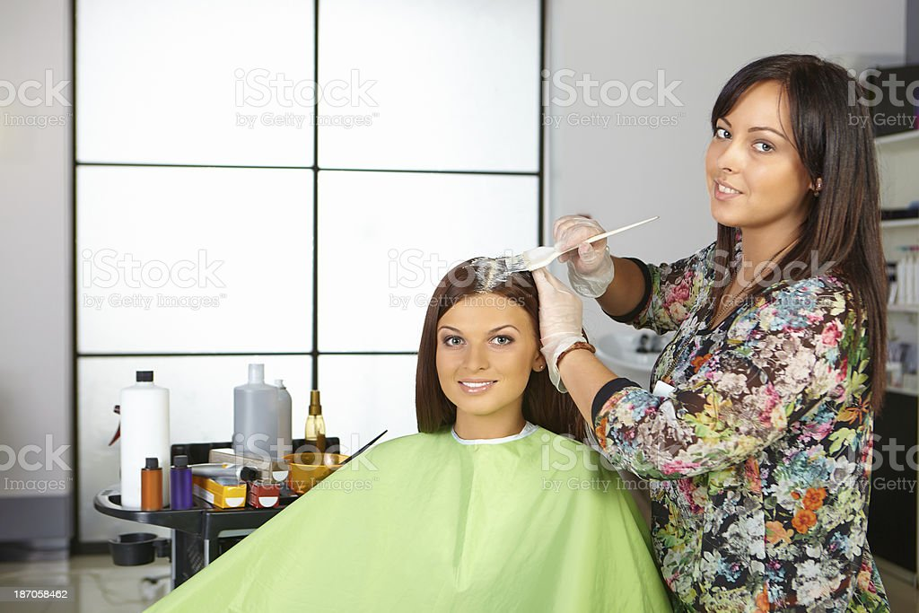 Hair salon. Coloring of roots. royalty-free stock photo