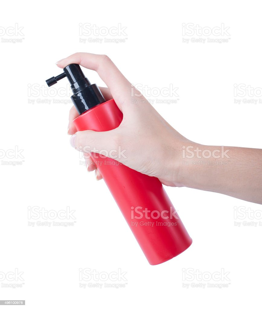 hair spray red bottle isolated on white background, pressing hand stock photo